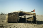 Guest tent with Omani flag set up for visitors