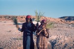Holding dwarf palm fronds at Wadi Baw well