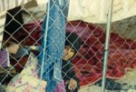 Young girl in fenced home